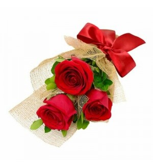 3 Red Roses. Hand Tied. Brown Wrapping.